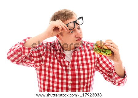 Funny man in glasses looking at hamburger isolated on a white - stock photo