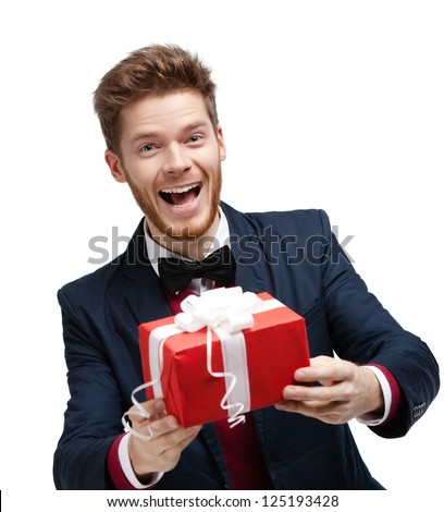 Funny man passes a gift wrapped in red packaging, isolated on white - stock photo