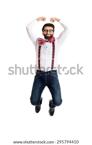 Funny man wearing suspenders jumping up. - stock photo