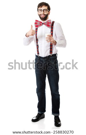 Funny man wearing suspenders with ok sign and glass of milk. - stock photo