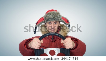 Funny man winter driving, car drive concept - stock photo