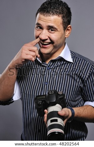Funny man with a digital camera