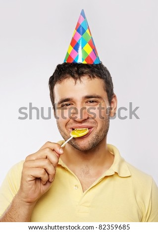 Funny man with a lollipop. - stock photo