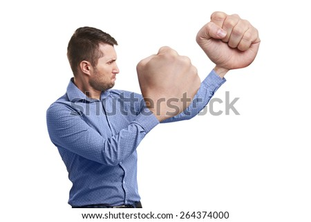funny man with big fists ready for fight. isolated on white background