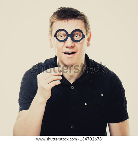 funny man with fake glasses - stock photo