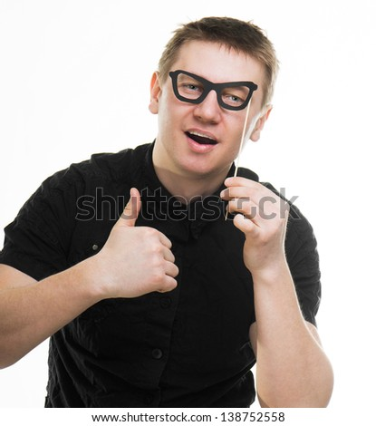 funny man with fake glasses thumbs up isolated on a white background - stock photo