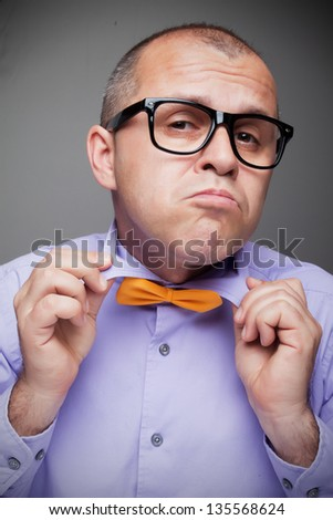 Funny man with glasses checking his outfit - stock photo