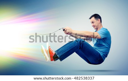 Funny man with joystick playing computer game, gamer concept