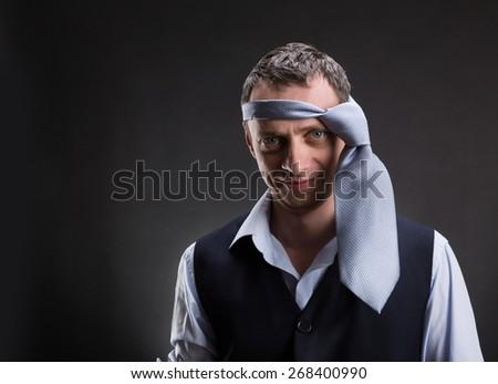 Funny man with necktie on his head - stock photo