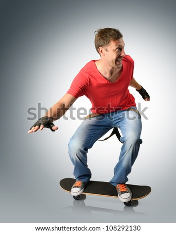 Funny man with suspender on a skateboard - stock photo