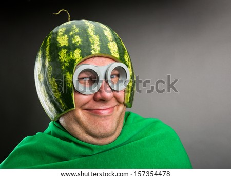 Funny man with watermelon helmet and googles looks like a parasitic caterpillar - stock photo