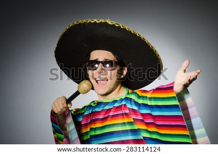 Funny mexican singing in karaoke - stock photo