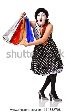 Funny mime in spotty dress holding shopping bags. Isolated over white - stock photo