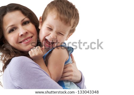 Funny mom and son smiling - stock photo
