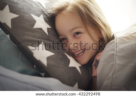 Funny moments in the bed - stock photo