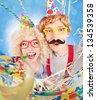 Funny nerdy couple celebrating - stock photo