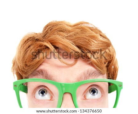 Funny nerdy guy looking up - stock photo
