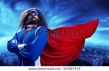 Funny nerdy superman  - stock photo