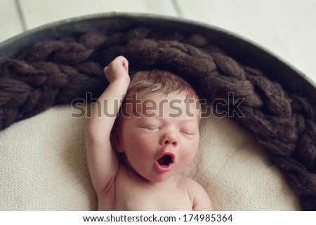 Funny Newborn baby boy dreaming of being a super hero - stock photo