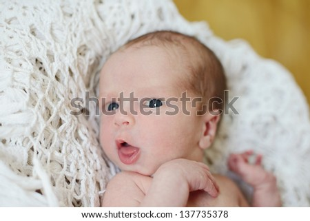 funny newborn with open mouth