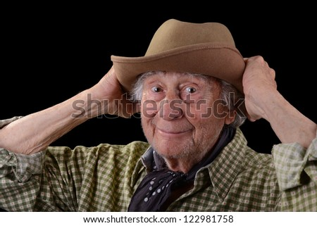 funny old man wearing a green checked shirt and a tan felt hat - stock photo