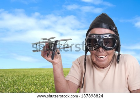 Funny old woman with a pilots hat and goggles - stock photo