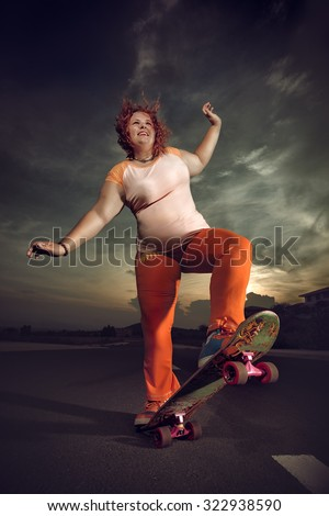 Funny overweight woman skateboarding. - stock photo