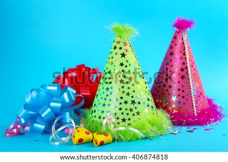 Funny party hats on blue background - stock photo