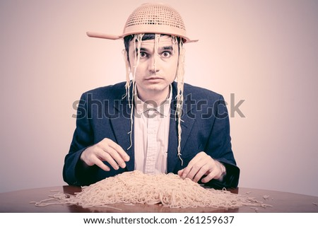 Funny Pastafarian with colander and pasta.