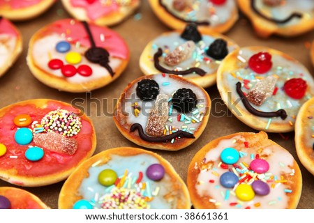 Funny pastry with faces for kids (birthday party)