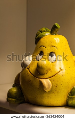 Funny pear face with out tongue and cap on head
