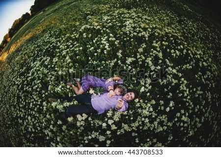 funny  people  lying on beautiful green meadow in the woods