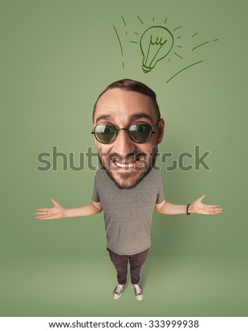 Funny person with big head and drawn idea bulb over it  - stock photo