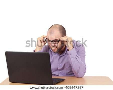 Funny photo of businessman bald with beard wearing shirt and glasses.  angry businessman working with laptop at table. Isolated on white background