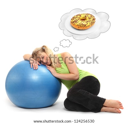 Funny picture of a hungry overweight woman dreaming on the ball. Weight loss concept. - stock photo