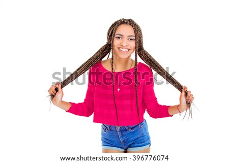 Funny picture of african young woman. Girl with African braids looking at camera and cheerfully smiling. Isolated background - stock photo