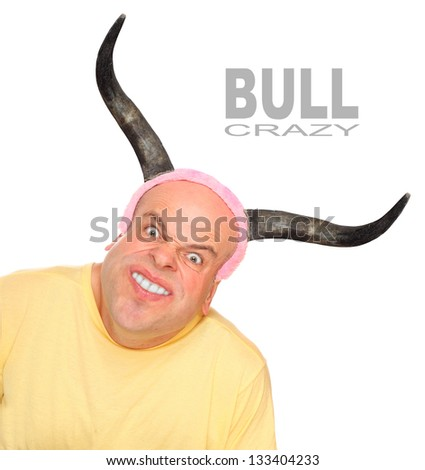 Funny picture of an powerful young man with bulls horns. Picture with space for your text.