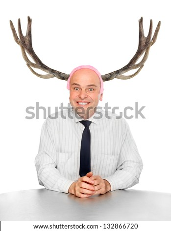 Funny picture of an stupid manager (husband) with great antlers. - stock photo