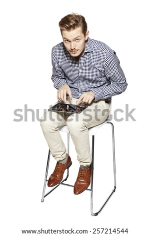 Funny picture of man working on a tablet - stock photo
