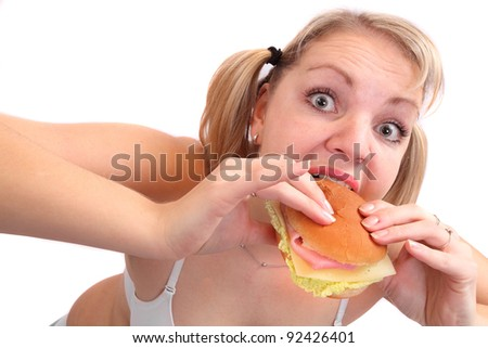 Funny picture of overweight woman eating tasty sandwich. - stock photo