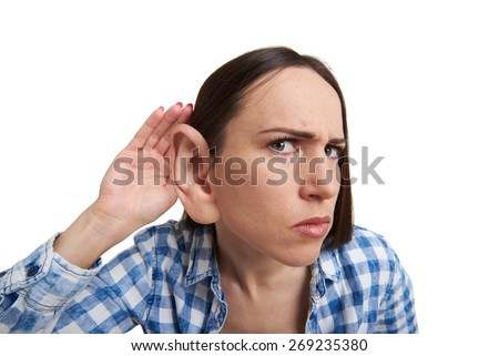 funny picture of serious woman with one big ear listening attentively and looking at camera. isolated on white background - stock photo