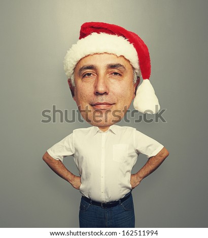 funny picture of smiley santa man over dark background