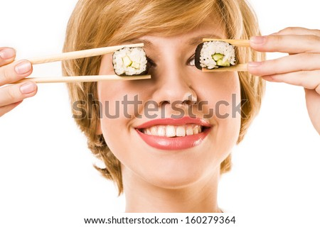 Funny picture of woman holding sushi rolls on her eyes