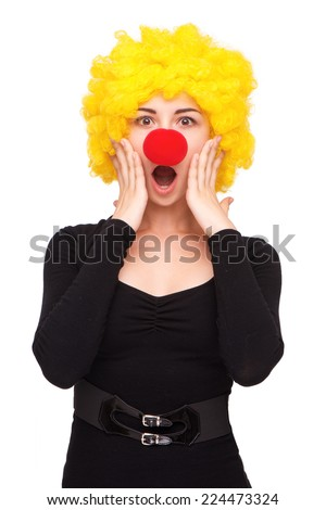 Funny picture of young business woman wearing clown wig and nose, isolated on white - stock photo