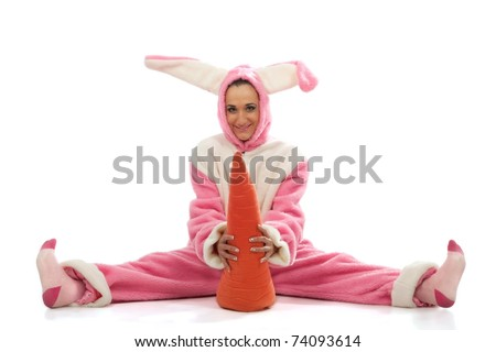 Funny pink rabbit with big carrot isolated on white background - stock photo