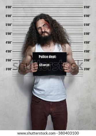 Funny portrait of a skinny hardened criminal - stock photo