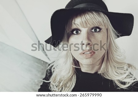 Funny portrait of a young frightened woman - stock photo