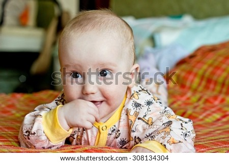 Funny portrait of adorable baby boy - stock photo