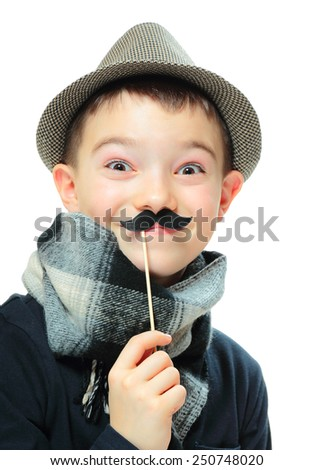 Funny portrait of boy wearing a hat with party mustache on white background - stock photo