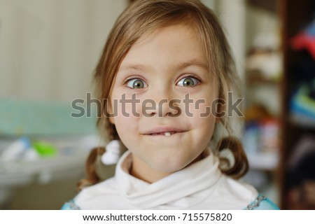 funny portrait of girl with wobbly tooth